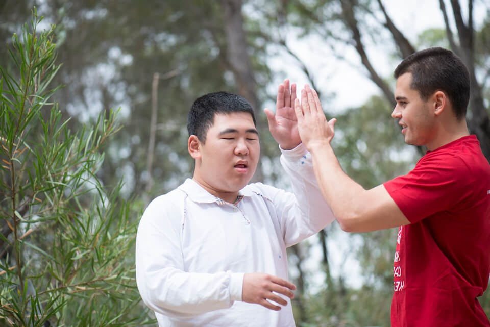 Two men giving each other a high five